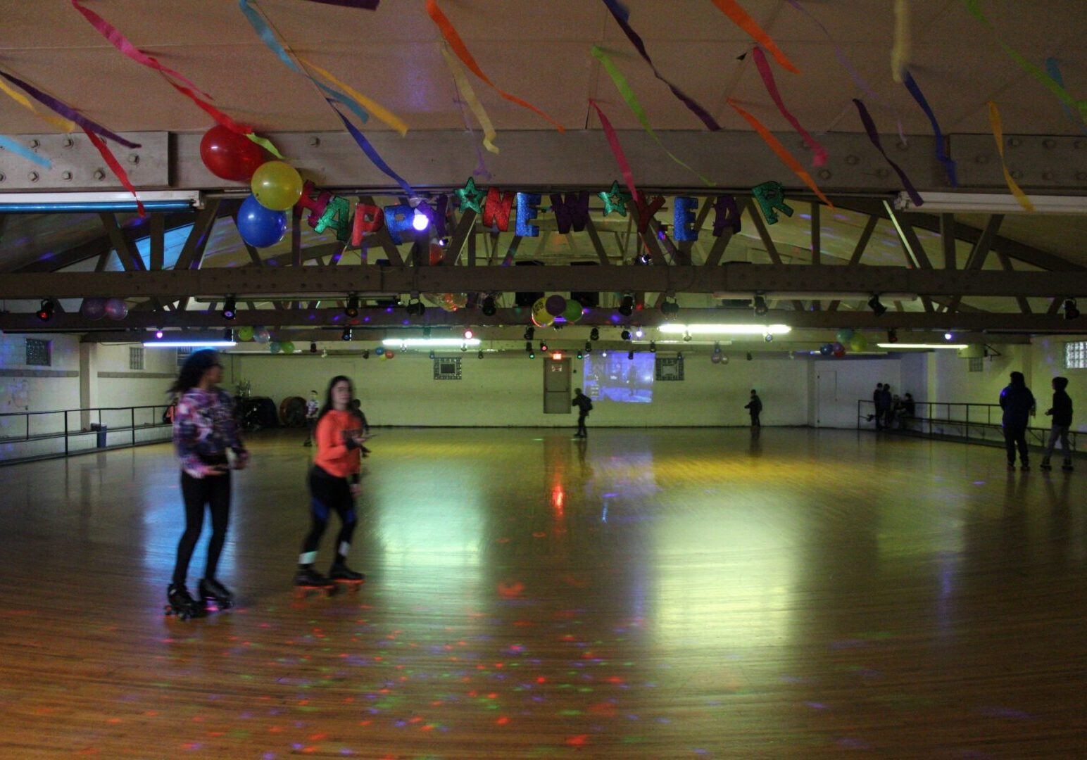 Customers skating on our wooden roller rink